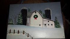 this is a hand painted barn on a cake pan