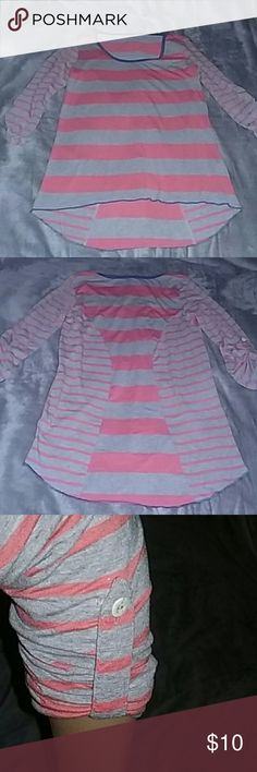 Grey & Orange Stripe Blouse This cute grey & orange stripe blouse has blue jean colored trmming around neckline and hemline.  3/4 sleeves with  gathering up feature  (see 3rd pic ). Very tiny hole in back, neckline inner hem, (see 4rth pic ), not noticeable.  Size M/L Made of cotton,  rayon,  polyester and spandex.  Preloved  No trades Firm Price Unknown  Tops Blouses