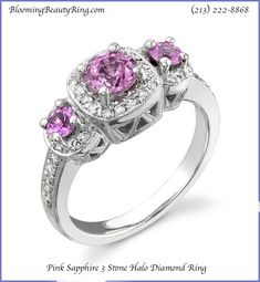 A gorgeous Pink Sapphire 3 Stone Halo Diamond Ring.  The Pink Sapphires can be replaced with any choice of diamond or precious gemstone.  Handmade and available in any metal you choose.  BloomingBeautyRing.com  (213) 222-8868