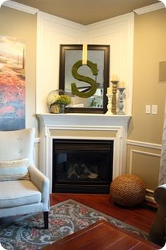 How to decorate a corner fireplace. Maybe a circle wreath instead of the S? (Even though an S would work for us... :)