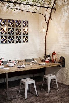 dining space in outdoor nook. Ideally would like to replace the window in the living room with a repurposed industrial door or pair of industrial doors (with windows of course!) that would allow for private access by opening up directly onto the patio (private outdoor nook)