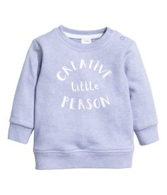 Light purple. Sweatshirt with snap fasteners on one shoulder and ribbing at neckline, cuffs, and hem.