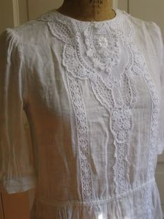 I love dresses like these. White linen, lace, possibly victorian...and very old.