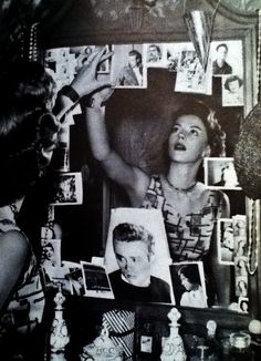 Natalie Wood putting up photographs of James Dean in her dressing room after his death.