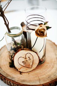 If we could get someone to cut slices of wood like that we could modge podge engagement/family pics onto them and put the centerpieces on top!