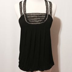 Openwork Trim Black Knit Top This top is fantastic! Featuring double openwork strap with open work detail on bodice, racer back, elastic hem.   95% viscose 5% spandex  Hand wash Boutique Tops Tank Tops