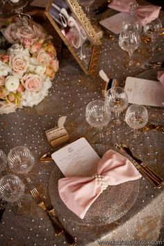 i like the napkin idea of a bow. And the mirror numbered table, pretty cool.