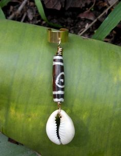 Ear Cuff with cowrie shell and dZi style bead.