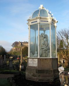 Wigtown Martyrs Monument, Old Town Cemetery, Stirling, Scotland: depicts Margaret Wilson reading the Bible with her young sister Agnes, watched over by a despairing guardian angel.