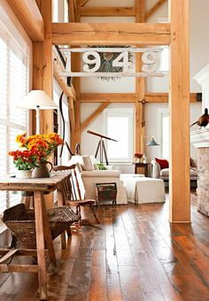 A soaring great-room in an Ohio room. Click for more pictures of this barn-style home.