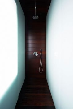 wood wrapping floor, wall and ceiling: house a | shower~ vaillo + irigaray | beguiristain