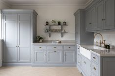Utility rooms help to keep a home running smoothly as well as freeing up valuable space in the kitchen. Head to the @humphreymunson blog for expert advice and fabulous designs such as this Hertfordshire project with timeless Nickleby cabinetry painted in H M Windward, which incorporates our Ionian mixer with crosstop handles and rinse in aged brass 📸 @paullmcraig #perrinandrowe #utilityroomideas #utilityroomdesign #utilityroomdecor #utilityroomorganisation #homedesignideas #laundryroom Kitchen Sitting Areas, Utility Cupboard, Cupboard Doors, Utility Room Designs, Humphrey Munson, Swedish Interiors, Handmade Kitchens, Open Plan Kitchen, Kitchen Ideas