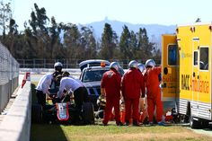 Fernando Alonso Photos - Fernando Alonso of Spain and McLaren Honda receives medical assistance after crashing during day four of Formula One Winter Testing at Circuit de Catalunya on February 22, 2015 in Montmelo, Spain. - F1 Testing In Barcelona - Day Four