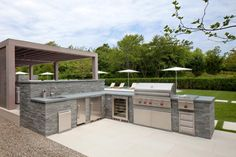 HGTV: LaGuardia Design Group created a backyard oasis with a large swimming pool, a modern pergola, and an outdoor shower, kitchen and fireplace. The pergola features multiple seating areas, a dining space and a concealed flat-screen TV. Modern Outdoor Kitchen, Backyard Kitchen, Outdoor Dining, Outdoor Kitchens, Modern Patio, Patio Dining, Outdoor Spaces, Modern Pergola, Outdoor Pergola