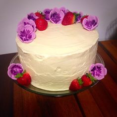Purple flowers and strawberry baby shower cake