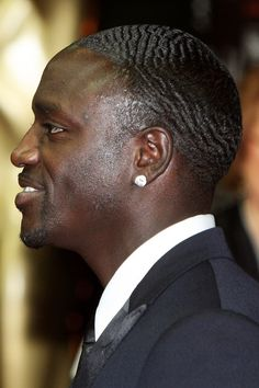 Cool Very Short Buzz Hairstyles for Black Men from Akon, http://globezhair.com/tag/black-men-hairstyles/