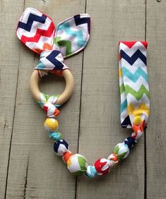Lessons I've Learned from Sewing Teddy Bears Rainbow Zig Zag Tula snap teether rainbow Tula by TheTeethingFairy: Handgemachtes Baby, Baby Kind, Baby Toys, Baby Sewing Projects, Sewing For Kids, Sewing Crafts, Sewing Toys, Wooden Teething Ring, Diy Teething Toys