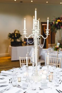 Ivory candelabra centrepiece, white, candles, tea light holders at Matara Centre, Gloucestershire, wedding styling by Elizabeth Weddings, photo by Bigeye photography Candelabra Centerpiece, Centerpieces, Spring Weddings, Real Weddings, White Candles, Industrial Wedding, Tea Light Holder, Table Runners, Tea Lights