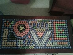 Bottle cap coffee table... Made it myself. ;-)