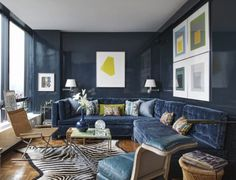 Navy blue lacquered walls and blue velvet seating. Todd Alexander Romano | New York City, New York