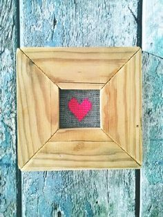 cross stitched heart on fly net by adi israel