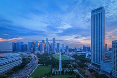 Singapore Skyline at Sunset Art Print by Rick Deacon. All prints are professionally printed, packaged, and shipped within 3 - 4 business days. Sunset Art, All Print, Color Change, Singapore, New York Skyline, Skyscraper, Fine Art Prints, Neon Signs, Clouds