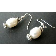 Price :$4.49 Sterling Silver White Genuine Freshwater Pearls & Bali Silver Earrings Material : White Freshwater Pearl 12mm with bali silver  Length : 3/4 inch  Weight : 3.5gms(31.1 gms = 1 oz)  Metal : Genuine Sterling Silver 92.5 French Wire Earrings