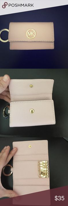 Blush Pink Michael Kors Key & Card Holder Blush pink soft leather Michael Kors key & card holder. Has 6 key rings, an two card slots for debit or ID cards. Brand new, never used just ripped off the tags by accident. Perfect condition and leather is clean. Michael Kors Bags Clutches & Wristlets