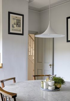 Mid century inspired renovation of victorian house by Hannah Gooch. Walls in French Grey Pale by Little Greene, Round carrara marble tulip table and vintage chapel chairs. Semi pendant light by Gubi. Victorian Hallway, Interior Architecture, Interior Design, Little Greene, Kitchen Seating, Dining Room Inspiration, Victorian Homes, Kitchen Lighting, Home Kitchens