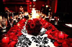 Black, Red and Silver / White color scheme for a wedding- Love the idea of having rose petals spread out on the tables!