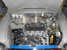 So clean. Definitely mechanical art! - Follow us for the best in daily Mini content! - #classicmini... Mini Cooper Classic, Mini Cooper S, Classic Mini, Classic Cars, Morris Traveller, Mini Morris, Mini Cooper Clubman, Mechanical Art, Car Mods