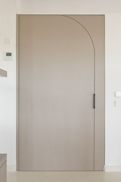 white pivot door hal