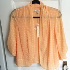 Polka Dot Flowy Blazer NWT! Lauren Conrad peach polka dot blazer. Wear sleeves long or rolled up with button. Looks great with a white flowy top and jeans! Feel free to make an offer :-) Lauren Conrad Jackets & Coats Blazers