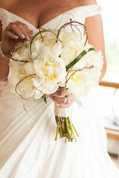 Becky's Peony Bouquet in White had a vintage, rustic feel because her wedding took place at a winery in South Jersey. Loops of grass and willow surround the white peony.