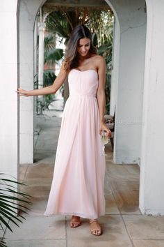 The Dahlia Maxi Dress in Blush is a stunning bridesmaid staple. It has the ability to be worn 5 different ways and is neutral in colour which means this dress really does suit all different shapes and sizes, perfect for a bridal party. Change from strapless for a smaller bust to halter neck for a...