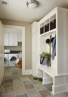 Mudroom idea. Love the open space at the bottom of the shelving unit.