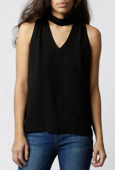 "Black chiffon tank featuring a v-neck, cinched shoulders and attached tie to style in front or back. Fully lined.       Measurements:   Shoulder: 11""   Chest: 17""   Length: 23""   Measurements taken from a size S       Model shown wearing a size S       - 100% Polyester   - Hand wash cold, hang dry   - Imported"