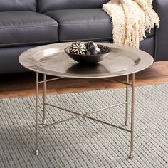 The fine hand-hammered appearance of this coffee table will lend your home a sophisticated, global appeal. The antique nickel finish offers a strong, durable finish, allowing this coffee table to stand the test of time.