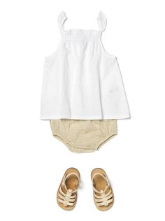 simple white top with butter bloomer and gold sandal