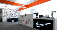 Creative agency Rosie Lee has redesigned Nike's London offices using a variety of custom graphics, workspace types, and themes to further establish the team's creative culture.