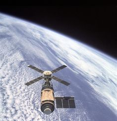 An overhead view of the Skylab Orbital Workshop in Earth orbit as photographed from the Skylab 4 Command and Service Modules (CSM) during the final fly-around by the CSM on Feb. 8, 1974.