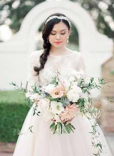 Just a touch of a cascading effect. Large Peach and White Floral Bouquet | Photo: Kristina Adams Photography