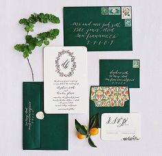 Emerald green and patterned invitations by Little Miss Press.