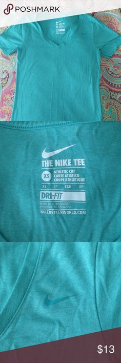 Nike | Dri-Fit Aqua Tee XS EUC Nike Dri-Fit short sleeve top. Aqua color, very soft. Only selling because I prefer the length of size Small Nike tops now. Reasonable offers welcome. Nike Tops Tees - Short Sleeve