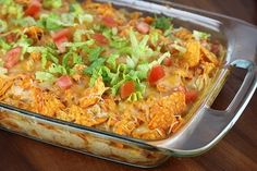 Dorito Chicken Casserole Recipe 2 cups shredded cooked chicken 2 cups shredded Mexican cheese blend (divided) 1 (10 oz) can cream of chicken soup ½ cup milk ½ cup sour cream 1 can Ro-tel tomatoes (drained) ½ packet taco seasoning 1 large bag Doritos Shredded lettuce (optional) diced tomato (optional)