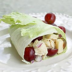 Chicken+Peanut Butter Lettuce Wraps  iceberg or romaine lettuce leaves Filling: ½ to ¾ c. chopped Fuji apple (about 1 apple); 1 c. cooked chicken (I boiled mine with salt, pepper,+onion); 20 red grapes, halved; ½ c. chopped red onion; ¼ tsp. salt Sauce: 1 Tbsp. light mayo; 1 Tbsp. honey; 1 Tbsp. all-natural creamy peanut butter  Mix all filling +then pour sauce+mix. Spoon into fresh, crispy lettuce leaf+roll it up. Makes four lettuce wraps.