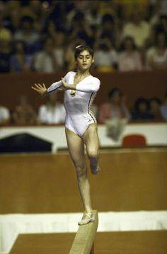 leotards are really having a moment right now. Gymnastics Pictures, Sport Gymnastics, Artistic Gymnastics, Olympic Gymnastics, Olympic Sports, Olympic Games, Gymnastics History, Nadia Comaneci Perfect 10, Nadia Comaneci 1976