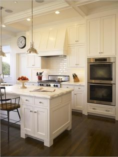 white kitchen- pendant lighting- range hood