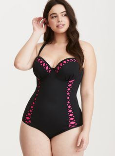 """<div>This one piece swimsuit is causing a major heat wave. The form-fitting and sheeny black number rocks hot pink trim on the cups and down the sides, contrasted with attention-grabbing lattice straps. The Push-Up Demi bodice gives your bust a major lift but the padding can also be removed. Adjustable straps can be worn straight or crossed. Power mesh lining.</div><div><ul><li style=""""list-style-position: inside !important; list-style-type: disc !imp..."""