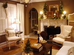 I like the idea of a white/cream, gold, and green color scheme for Christmas. Also, I like that this mantel is festive but understated.